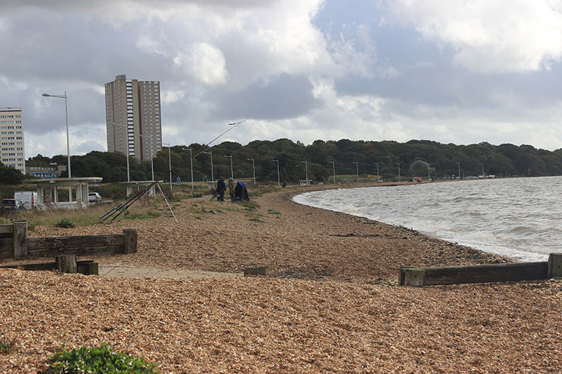 The beach is located nearby the Royal Victoria Country Park.