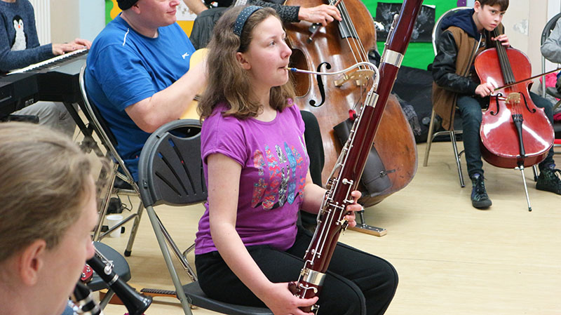 A huge variety of instruments were brought along – this girl played both the bassoon and the ukulele.