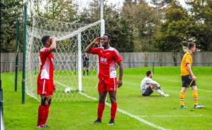 Kasimu and Obeng salute each other after making the score 2-0 PHOTO CREDIT: Tom Mulholland
