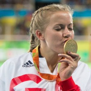 Hannah kisses one of her five Paralympic Gold Medals (Photo HannahCockroft/Twitter)