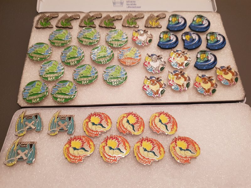 Some of the badges given out to local players on previous community days.
